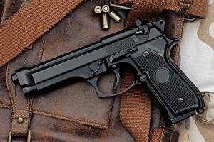 Handgun Sitting Atop a Bag